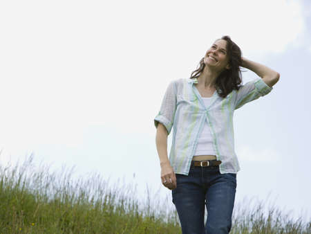 ebullient: Low Angle View Of A Woman Laughing In A Field LANG_EVOIMAGES