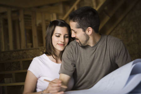 Young Couple Discussing A Blueprint