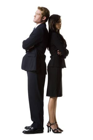 Businessman And Businesswoman Standing Back To Back LANG_EVOIMAGES