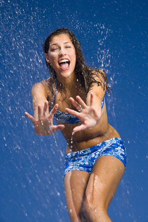 Close-Up Of A Young Woman Getting Sprayed With Water