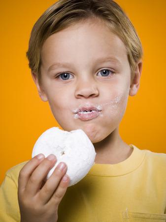 Boy Eating Donut