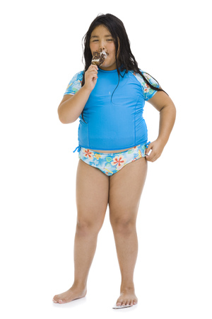 Overweight Young Girl Eating Ice Cream Bar