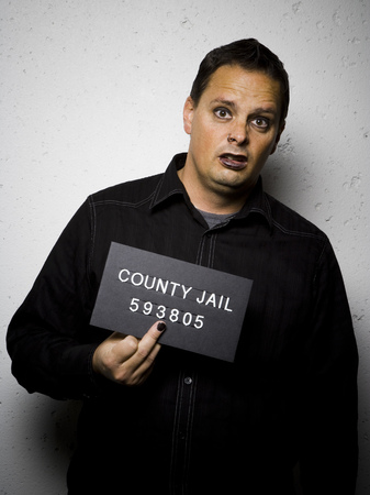 incarcerated: Mug Shot Of Gothic Man LANG_EVOIMAGES