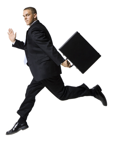 Businessman Jumping With Briefcase LANG_EVOIMAGES