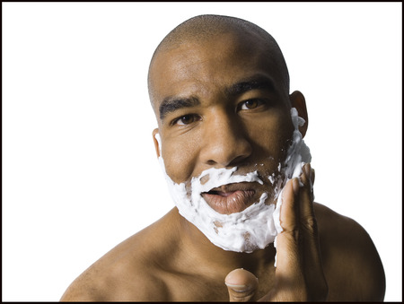 Man With Shaving Lotion On Face LANG_EVOIMAGES