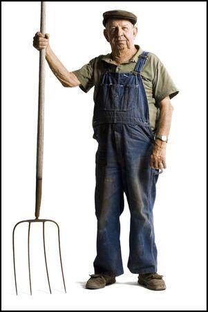 pitchfork: Farmer Holding A Pitchfork LANG_EVOIMAGES