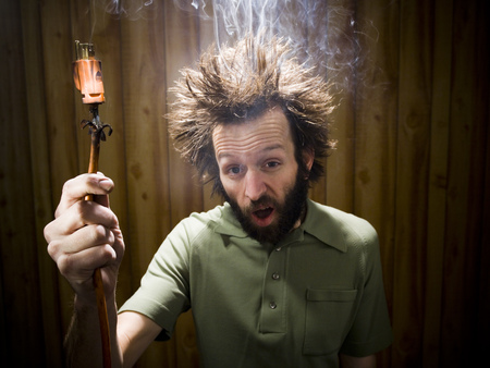 or electrocution: Man After Electric Shock With Electric Plug And Smoke LANG_EVOIMAGES