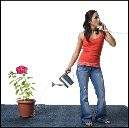 distractions: Distracted Woman Watering Flowers But Missing The Pot LANG_EVOIMAGES