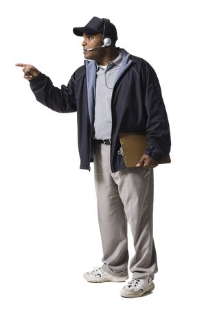 Coach With Clipboard And Headset Pointing