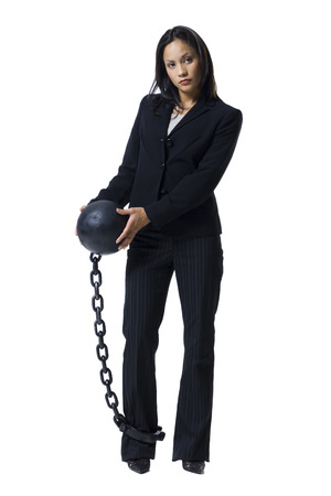 Businesswoman Shackled To Ball And Chain