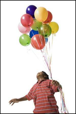Young Boy With Balloons LANG_EVOIMAGES