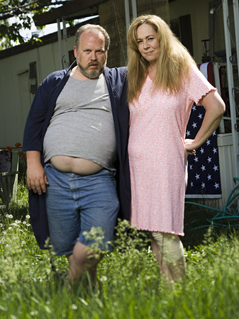 Overweight Couple In A Trailer Park