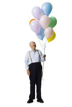 Older Man Holding Balloons