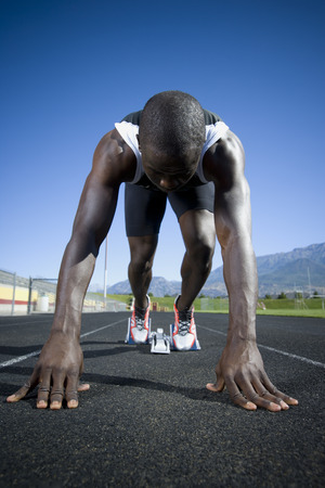 Track Runner In Starting Position Ready To Race LANG_EVOIMAGES
