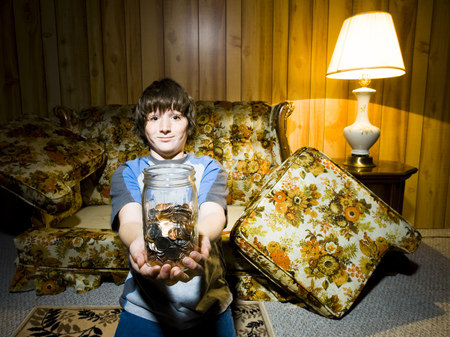Boy With Coin Jar Smiling