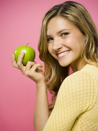 Woman Smiling With Green Apple