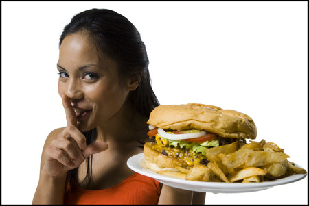 Woman Eating A Supersized Hamburger LANG_EVOIMAGES