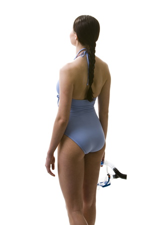 Rear View Of Woman In Bathing Suit Holding Snorkel