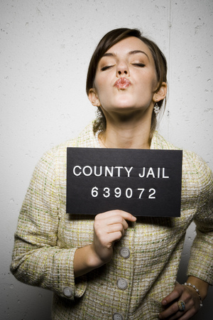 incarcerated: Mug Shot Of Formally Dressed Woman LANG_EVOIMAGES