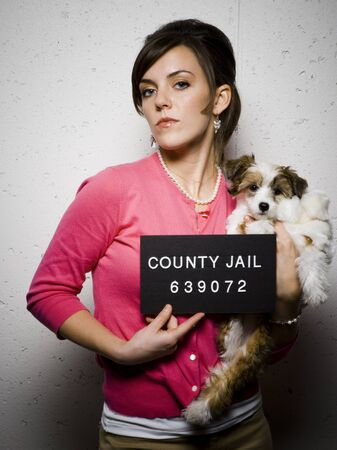incarcerated: Mug Shot Of Woman With Dog
