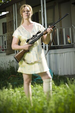 Woman In Trailer Park With A Rifle