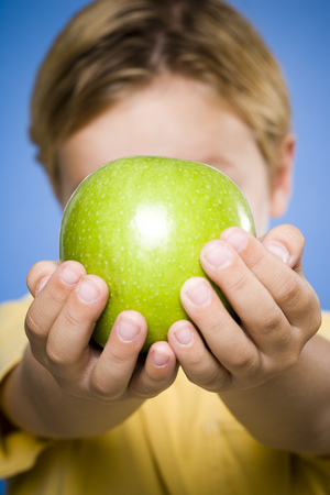 Boy With Green Apple Smiling
