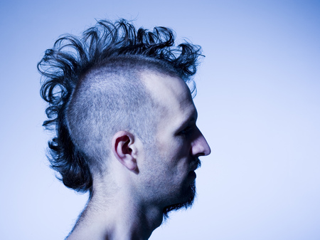 esquizofrenia: Side Profile Of Man With Half Shaved Hair And Beard