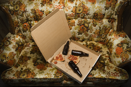 Pizza Box And Beer Bottles On Sofa