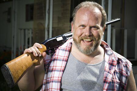 Overweight Man With A Shotgun