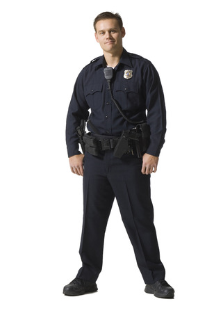 Male Police Officer Standing With Arms Crossed Smiling