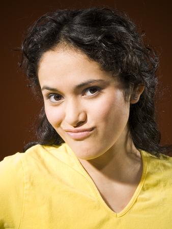 Portrait Of A Woman Smirking LANG_EVOIMAGES