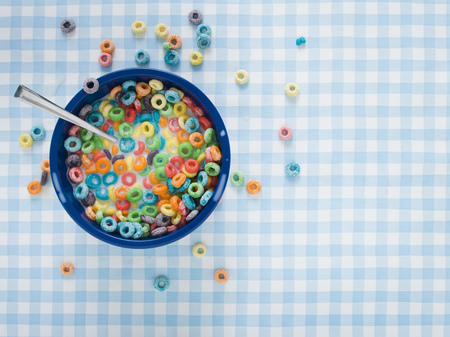 Bowl Of Cereal With Milk And Cereal On Tablecloth