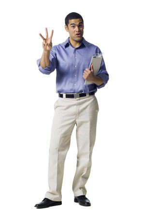 Man Standing With Clipboard Pointing