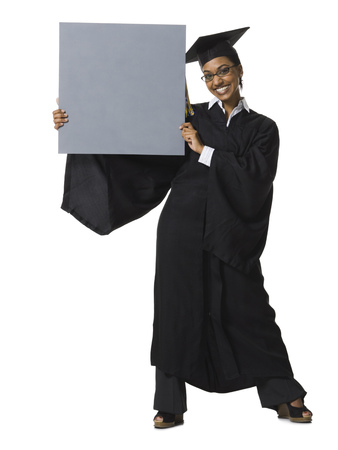 Woman In Graduation Gown And Blank Sign With Blank Sign