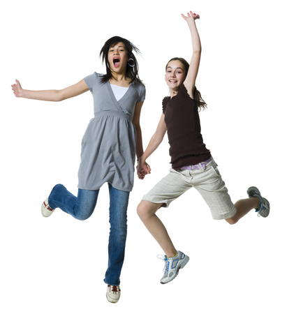 Two Girls Jumping And Smiling LANG_EVOIMAGES