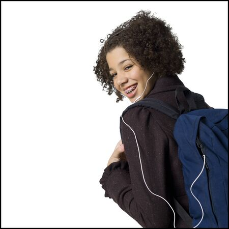 Girl With Backpack And Earbuds Smiling With Braces