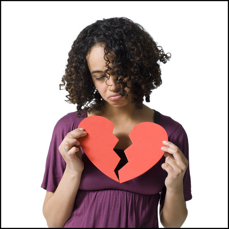 Woman Holding Broken Red Heart