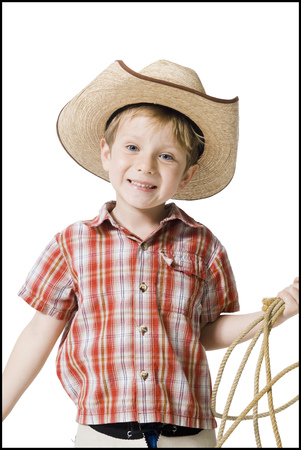 Boy With Cowboy Hat And Lasso
