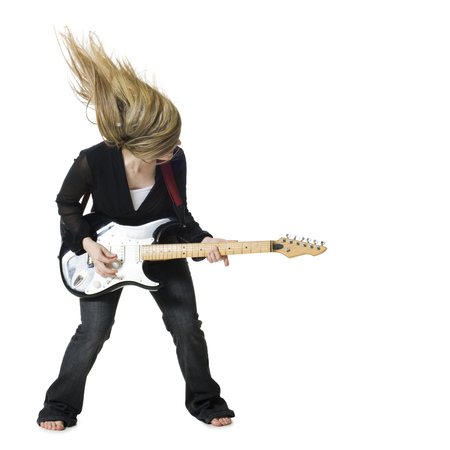 Woman Playing Electric Guitar LANG_EVOIMAGES
