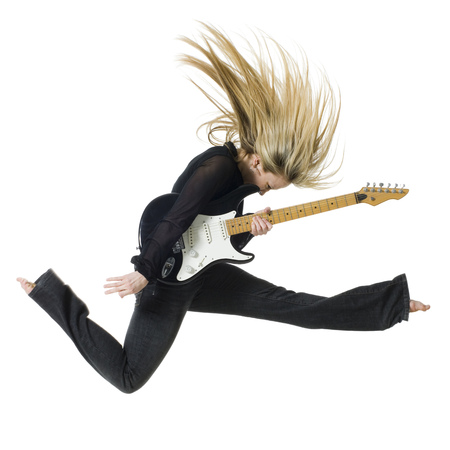 Profile Of Woman Jumping With Electric Guitar LANG_EVOIMAGES