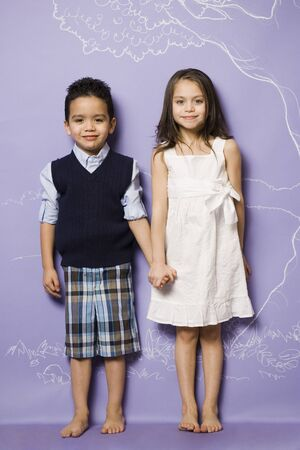 Young Girl And Boy Holding Hands Smiling