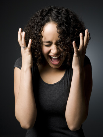 Woman With Mouth Open And Closed Eyes With Hands On Face LANG_EVOIMAGES