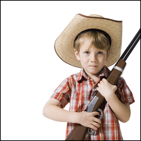 Boy With Toy Rifle And Cowboy Hat LANG_EVOIMAGES