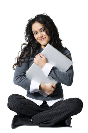 Woman Sitting Cross Legged Hugging Laptop