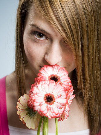 Profile Of Woman Smelling Flowers