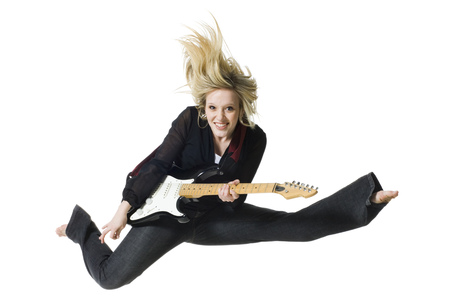 Woman Jumping With Electric Guitar