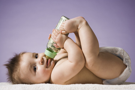 Baby Drinking From Bottle With Us Currency In It