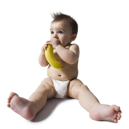 Baby Chewing On Banana LANG_EVOIMAGES
