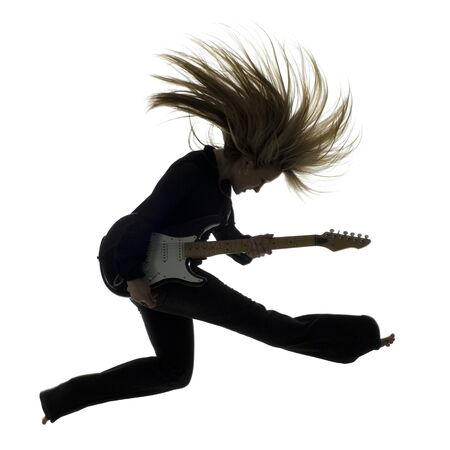 Side Profile Silhouette Of Woman Jumping With Electric Guitar