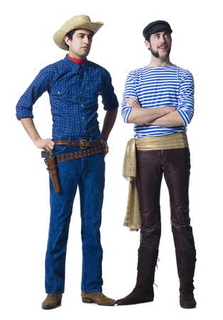 Man In Cowboy Costume And Man With Leather Pants And Waist Sash With Clenched Fists LANG_EVOIMAGES